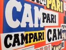 Multicolored Campari logo viewed at an oblique angle