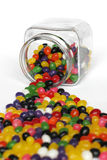 Multicolored candies. Candies spilling out of glass jar Stock Images
