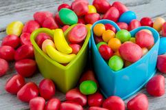 Multicolored candies in blue and green baking forms Royalty Free Stock Images