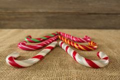 Multicolored candy canes arranged on fabric Stock Photo