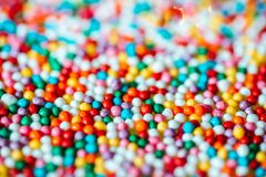 Multicolored candy on a green background royalty free stock images