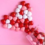 Multicolored candy or Pills in the shape of hearts. Romantic Valentine`s Day or Medicine, Pharmacy, Cardiology concept. Square image stock photography