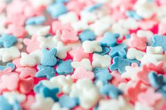 Multicolored candy on a pink background royalty free stock image