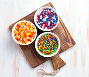 Multicolored candy sunflower seeds in the icing sugar and corn for Halloween. Stock Image