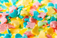 Multicolored candy on a yellow background royalty free stock photography