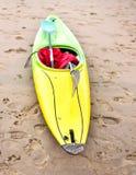 Multicolored canoe on the beach Stock Photos