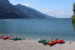 Multicolored canoe on the lake shore. Ready to sail Royalty Free Stock Image
