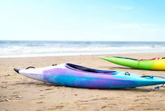 Multicolored canoes on the beach Royalty Free Stock Image