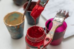 Cans of Gouache Paint with Paintbrush stock image