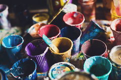 Multicolored cans with paint, arts background Stock Images
