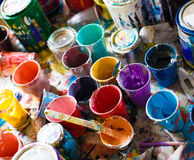 Multicolored cans with paint, arts background Royalty Free Stock Images