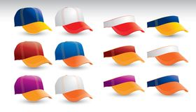 Multicolored caps and visors on white backdrop Royalty Free Stock Photo
