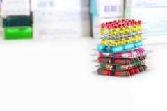 Multicolored capsules stock photos