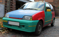 Multicolored car. Multicolored funny, little  car on street Stock Images