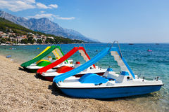 Multicolored catamaran on beach Royalty Free Stock Image