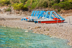 Multicolored catamarans on the beach. Multicolored catamarans on the pebbles beach in Croatia Royalty Free Stock Images