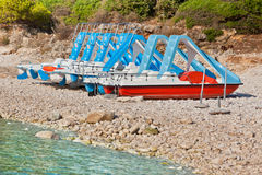 Multicolored catamarans on the beach. Multicolored catamarans on the pebbles beach in Croatia Royalty Free Stock Image