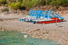 Multicolored catamarans on the beach. Multicolored catamarans on the pebbles beach in Croatia Stock Image