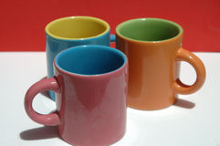 Multicolored ceramic cups Royalty Free Stock Images
