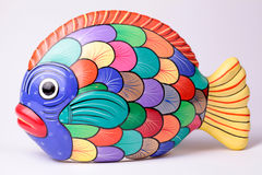 Multicolored ceramic fish on white background Stock Photos
