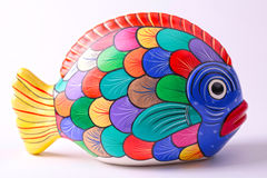Multicolored ceramic fish on white background Royalty Free Stock Photo