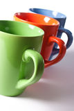 Multicolored ceramic mugs Royalty Free Stock Photography