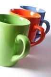 Multicolored ceramic mugs Royalty Free Stock Photography
