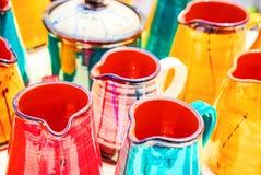 Multicolored ceramic mugs, close up Royalty Free Stock Photo