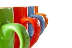 Multicolored ceramic mugs over white Stock Photo