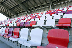Multicolored chairs on the stadium Royalty Free Stock Photos