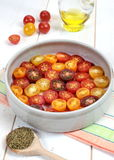 Multicolored cherry tomatoes, Provencal herbs, olive oil for roa Royalty Free Stock Photos