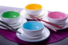 Multicolored Chinese bowls. With chopsticks Stock Photos