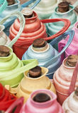 Multicolored Chinese thermos jugs. Arrangement of multicolored Chinese thermos jugs Royalty Free Stock Image