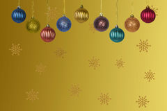 Multicolored Christmas balls on a gold background with snowflakes Stock Photo