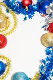 Multicolored Christmas balls with tinsel. Red, blue, golden Christmas balls with multi-colored tinsel on a white background Royalty Free Stock Photo