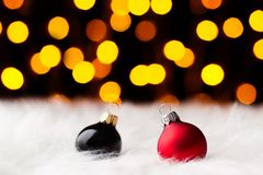 Multicolored christmas balls in white fur colored lights Stock Photo