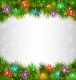 Multicolored Christmas lights on pine branches on grayscale Royalty Free Stock Photography