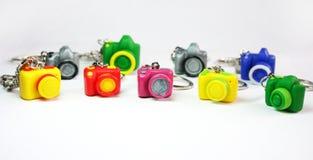 Multicolored cijferscamera's op de lijst Stock Fotografie