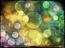 Multicolored circular background bokeh. In the colors of the spectrum conceptual of dreams and fantasy or a festive holiday occasion and party Stock Photos