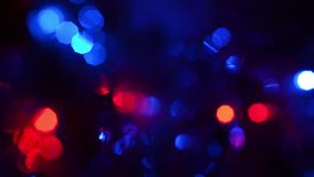 Multicolored circular flashing lights on a dark background, beautiful bokeh blue red green light in dark. stock footage