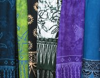 Multicolored Cloth 2. Description: Six multicolored sections of African-tapestry shown hanging vertically, side-by-side.  In order from left to right, the colors Stock Photos
