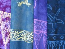 Multicolored Cloth 3. Description: Four multicolored sections of African-tapestry shown hanging vertically, side-by-side; in various shades of blue.  In order Royalty Free Stock Photos