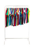 Multicolored clothes on hangers, isolate Stock Image