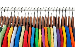 Multicolored Clothes On Wooden Hangers Royalty Free Stock Image