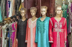 Multicolored clothes on a souk in Fez, Morocco Stock Image