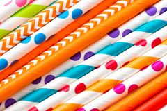 Multicolored cocktail tubes close-up holiday background stock image