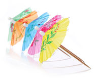 Multicolored Cocktail Umbrellas. Vacation and summer symbol, isolated. On white background stock photos