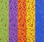 Multicolored collage of dry pasta spirals.Food background. Royalty Free Stock Images