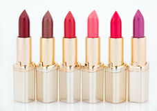Multicolored color lipsticks arranged in line Royalty Free Stock Photography