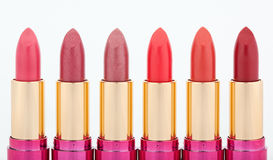 Multicolored color lipsticks arranged in line Stock Image